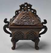A vintage 20th Century bronze Chinese censer having a pierced lid over a finely decorated body