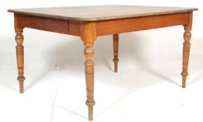 A 19th Century Victorian oak dining table of rectangular form having a stripped back tabletop over a