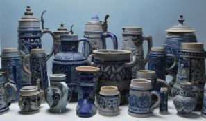 A collection of 20th Century German ceramic stein drinking glasses, each having raised decoration to
