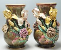 A pair of late 19th century Victorian large Majolica baluster vases, having applied floral details