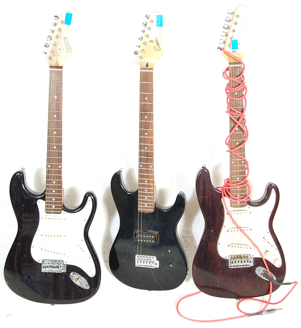 A collection of three vintage 90s electric guitars to include an Elevation...
