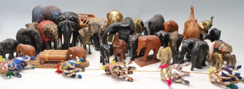 A large collection of vintage 20th century hand carved wooden elephants of various sizes having hand