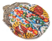 A vintage early 20th Century beaded ladies purse having a coloured bead floral design with a