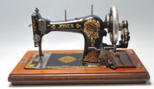 An original vintage mid century sewing machine by Jones Family painted black with gilt floral
