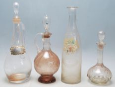 A collection of 18th century and 19th century Victorian glass decanters to include a two jug