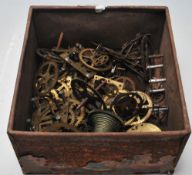 A collection of antique / vintage clock spare parts to include clock fusee movement parts, gear