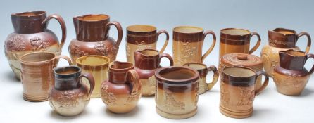 A collection of 19th Century Victorian ceramic Harvest ware jugs / drinking vessels / flagons,