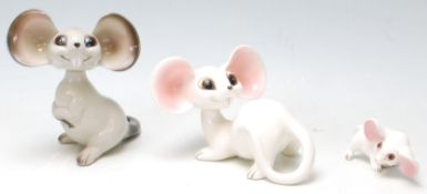 A group of 1960's vintage German ceramic mice comprising of a pair of white and pink mice sitting on