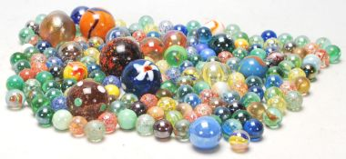 A collection of 20th Century glass marbles to include a wide selection of colours and styles to