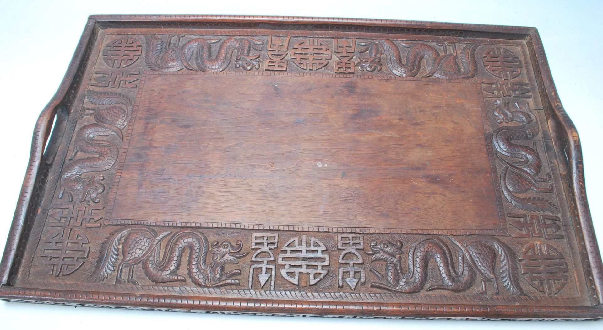Los 239 - An early 20th Century Chinese Qing Dynasty style carved hardwood rice wine serving tray decorated