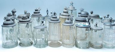 A collection of 20th Century German stein glass drinking glasses, some having raised decoration to