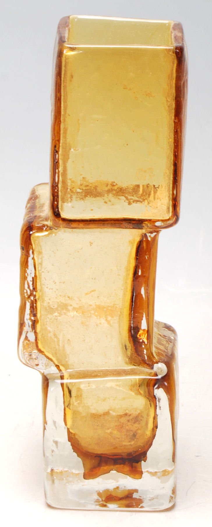 Lot 32 - Whitefriars (Manner Of) - A vintage amber glass ' Drunken Bricklayer ' type vase in the manner of