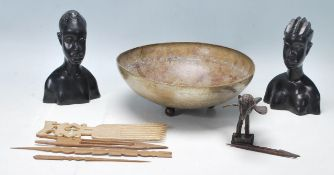 A collection of vintage tribal artefacts including an ashanti bronze in the shape of a bird, a