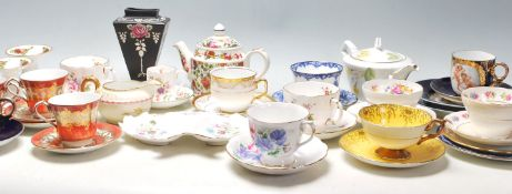 A collection of mixed vintage 20th Century mostly English china tea cups to include a Shelley rose