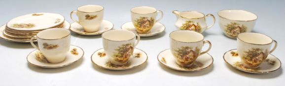 An early 20th century Alfred Meakin English tea service to include six cups, six saucers plates, a