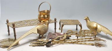 A good collection of antique 20th Century brass items to include French brass trivets stand with