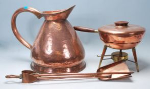A collection of 20th century copper items to include an Italian portable camping stove, raised on