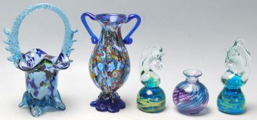 A collection of Murano and Mdina glass to include a pair of horse head paper weights, flower