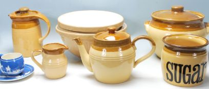 A collection of retro vintage mid century kitchenalia to include a ceramic kettle, jug, sugarpot,