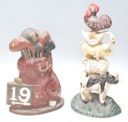 A pair of vintage mid 20th century cast iron polychrome doorstops, one in the form of golf bag