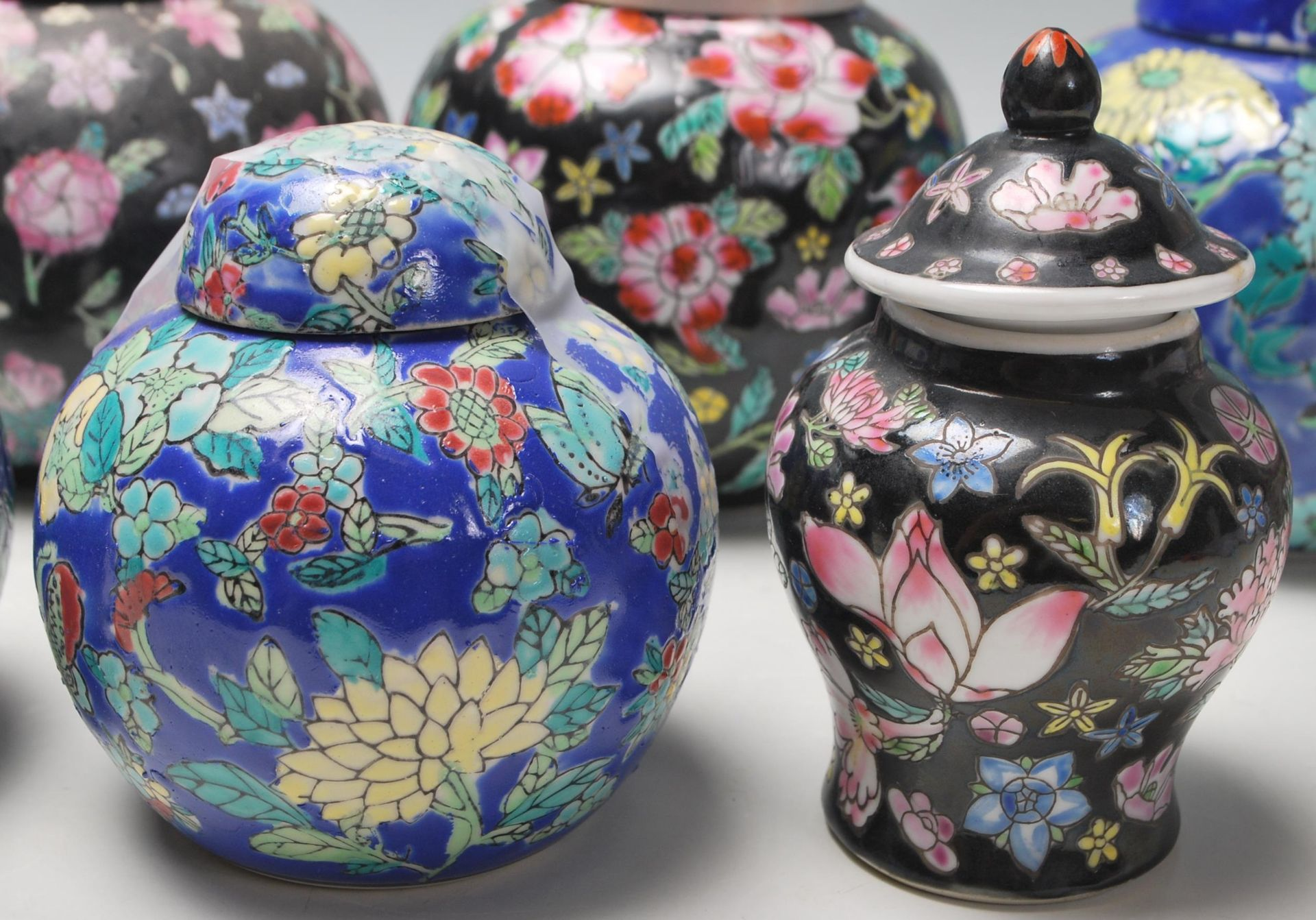 Los 72 - A collection of twelve 20th Century Chinese ginger jars all having hand enamelled floral sprays