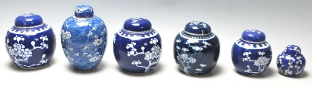 A group of 20th Century hand painted Chinese blue and white ginger jars of bulbous form al being