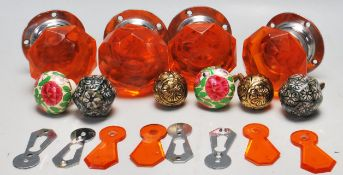 A collection of vintage 20th Century door furniture to include two orange glass faceted door