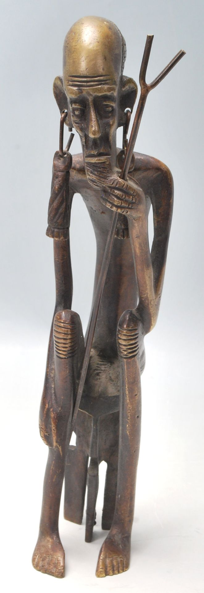 Los 252A - A vintage 20th Century Polynesian / Aboriginal bronze figure of a tribal elder with large earrings