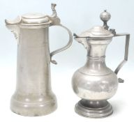 Two 18th Century pewter wine tankards having scroll handles and beak shaped spout with makers mark