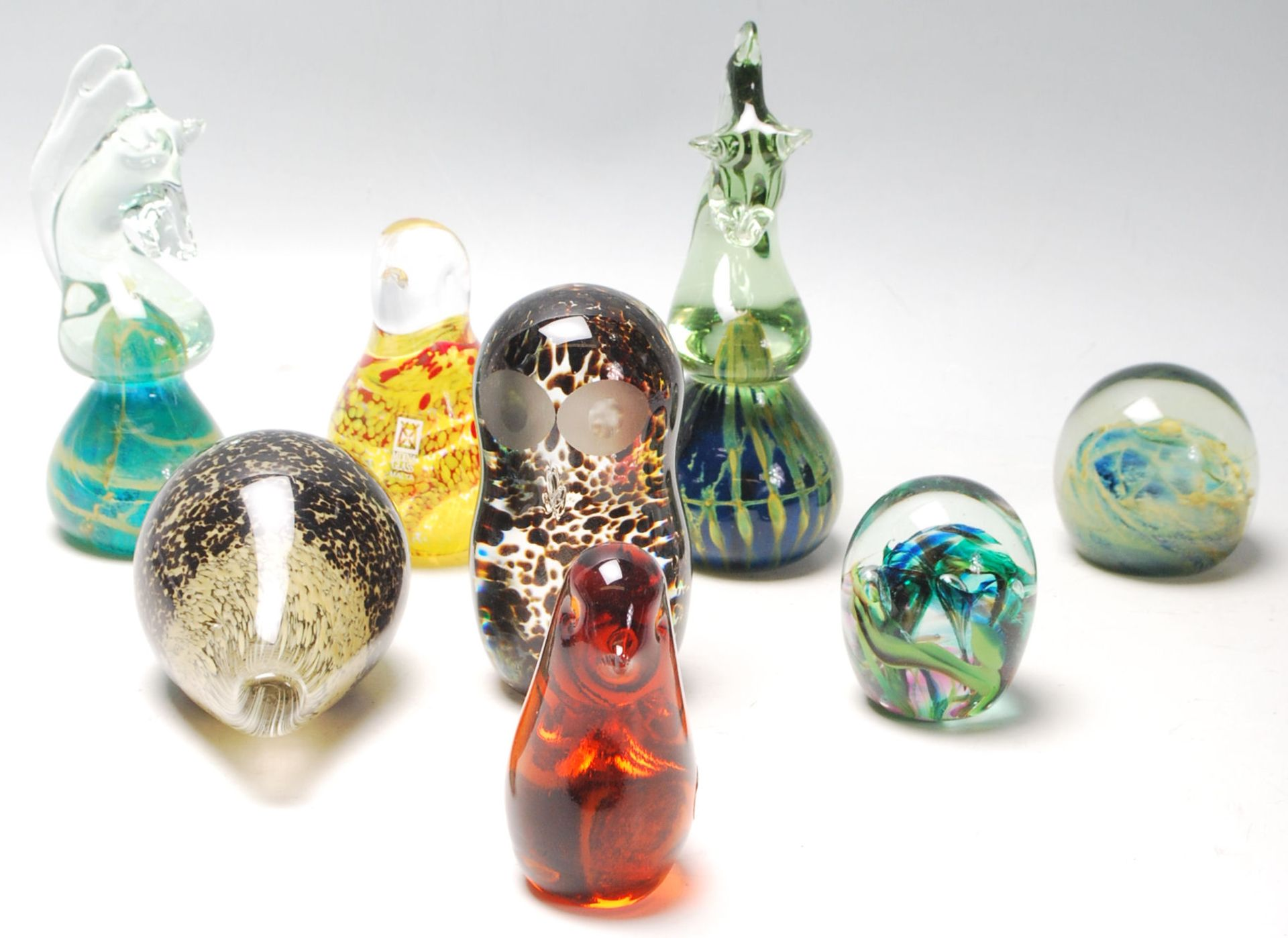 Los 14 - A good collection of eight mid century vintage retro studio art glass paperweights to include:
