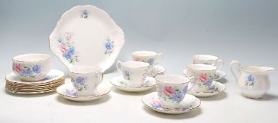 A Royal Albert Friendship Sweet Pea pattern fine bone china tea set comprising of 6 tea cups,