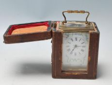 A 20ty Century French Brass and glass carriage clock are having white enamel face, Roman numerals