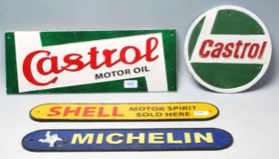 A collection of four 20th Century vintage style cast iron motoring related shop display / point of