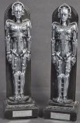 JULIAN GLOVER & ISLA BLAIR - PAIR OF METROPOLIS AWARD STATUES