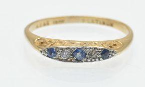 An 18ct Gold Platinum, Sapphire & Diamond Ring