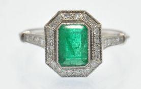 A Platinum Emerald & Diamond Cocktail Ring