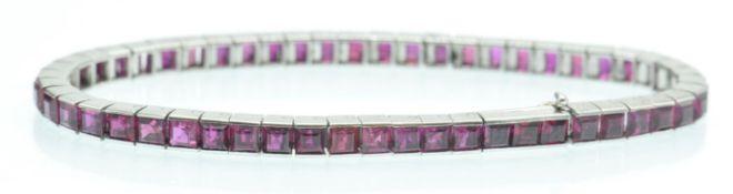 A French 14ct White Gold & Ruby Tennis Bracelet