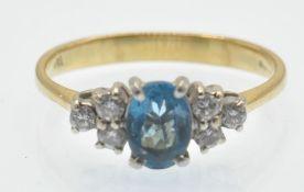 An 18ct Topaz & Diamond Ring