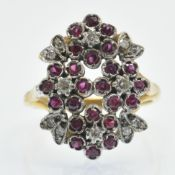 An 18ct Gold Ruby & Diamond Fancy Cluster Ring