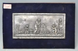A vintage resin plaque decorated with a single fem