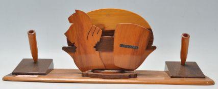 A retro mid century teak wood desk tidy of unusual