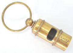 A brass replica whistle marked S Auld Maker Glasgo