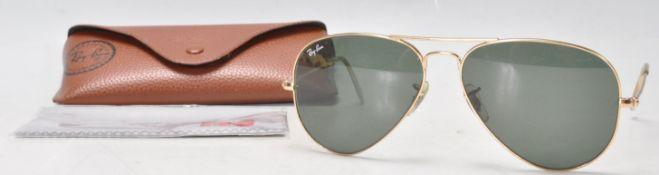 A pair of USA made Rayban gold tone Aviator sungl