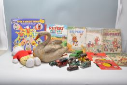 A collection of vintage children's toys to include