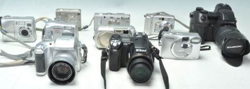 A collection of vintage digital cameras to include