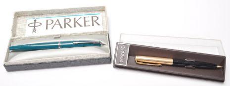 A vintage Parker ink pen having a turquoise plasti