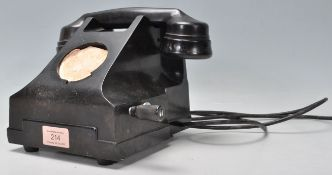 A vintage early 20th Century bakelite rotary dial