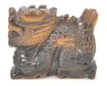 A small Chinese tiger's eye figure in the form of