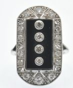 A platinum onyx and diamond plaque ring. The ring set with four round brilliant cut diamonds