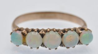 A French Gold & Opal Five Stone Ring